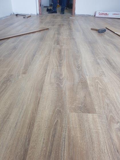 sàn gỗ công nghiệp chủng loại, bề dày như nào phụ thuộc chi phí sửa chữa văn phòng